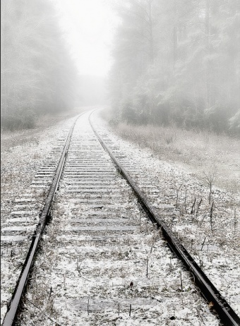 To walk on a railroad in the middle of nowhere..