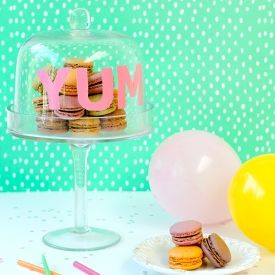 Make sure everyone knows what to expect under that cake dome with an easy stencil DIY!