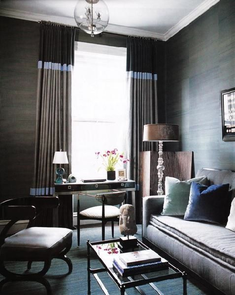 Color-block panels complement the tone of dark neutrals, crystal floor lamp with rectangular shade, striated walls.