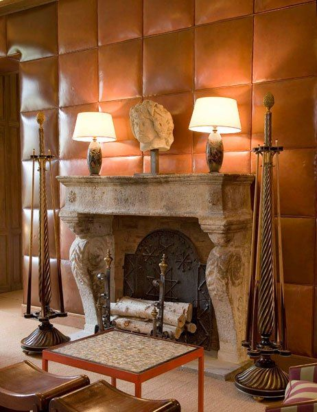 The Artistry of Paneling: Mid-'30s leather-sheathed walls by Frank, also for Guerlain, are paired with a 17th-century stone mantel