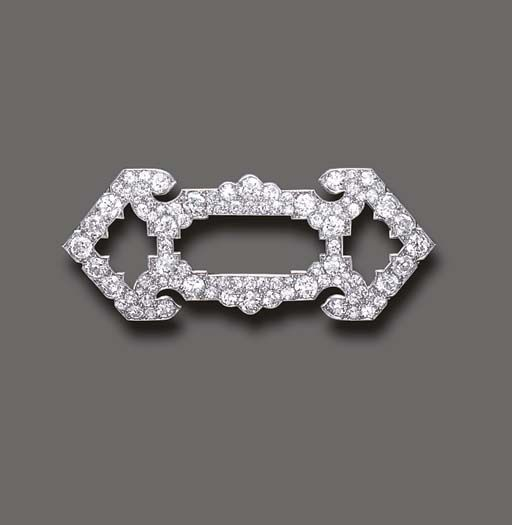 AN ART DECO DIAMOND BROOCH, BY CARTIER   Of openwork geometric design, set entirely with old European and single-cut diamonds, mounted in platinum, circa 1920  Signed Cartier, no. 3015775