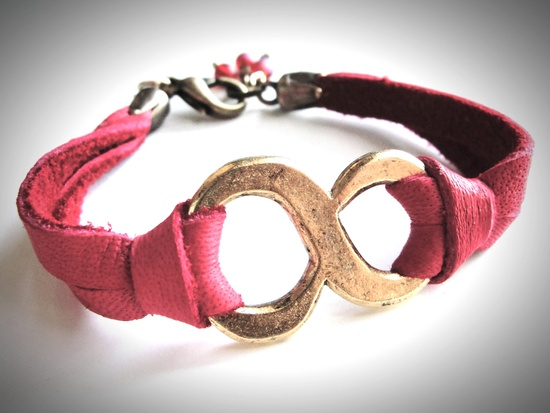 Big Brass Infinity bracelet on super soft red leather. $24, via Etsy.