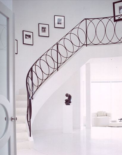 Contemporary but not sterile metal / iron banister and railing - Overlapping circle design - Simple but elegant