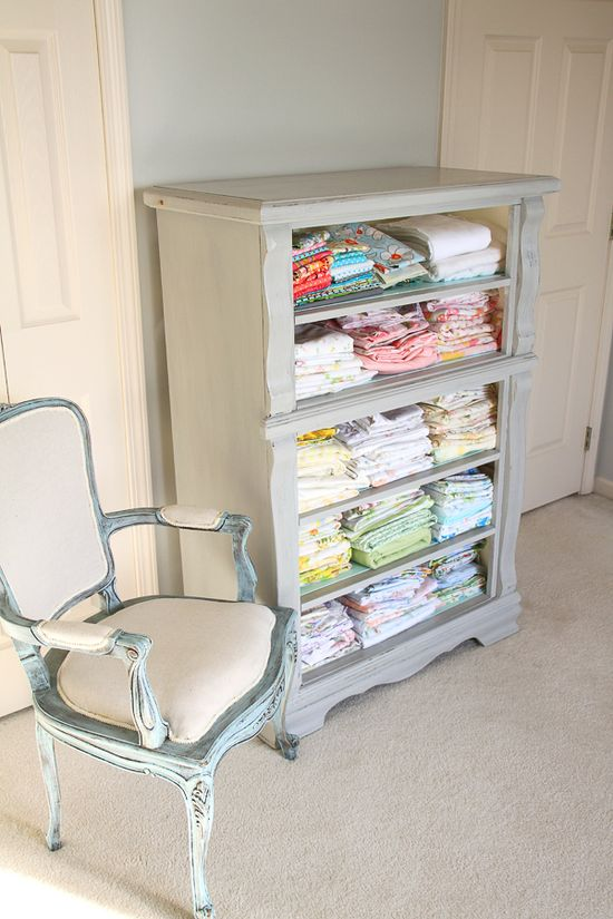 Drawer-less dresser turned fabric storage or towel storage for a bathroom.  Good idea!