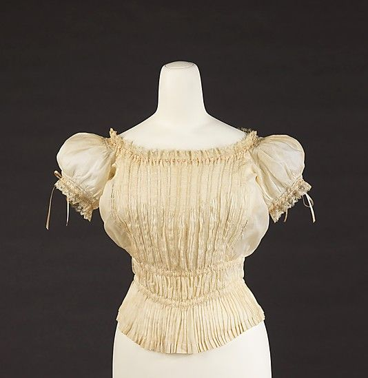 Cotton and silk pintucked corset cover with puffed sleeves and lace and ribbon trim, French, 1895-1900.
