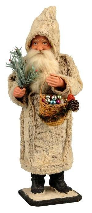 Rare Christmas candy container of Santa holding fir tree and carrying basket of ornaments, 15 inches tall, estimate $ 3000-5000.