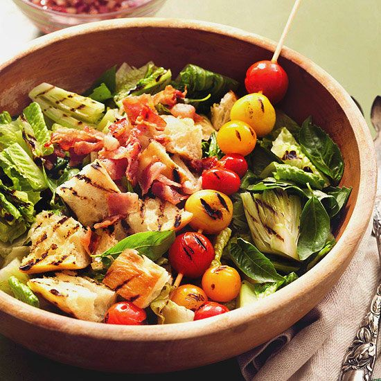 This savory grilled salad features bread, tomatoes, romaine hearts, and bacon. See more of our best grilling recipes: www.bhg.com/...