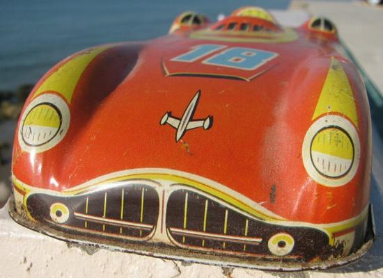 Vintage tin toy jet speedster.