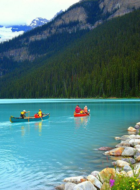 Canoes at Lake Louise in Banff National Park,...