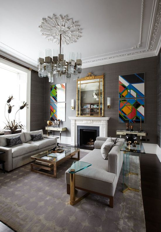 Modern furniture, lighting and art shine in this traditional room.