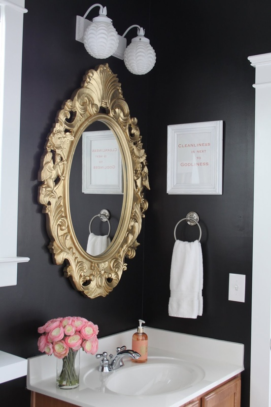 don't know if I could pull off a black bathroom, but I love the idea!