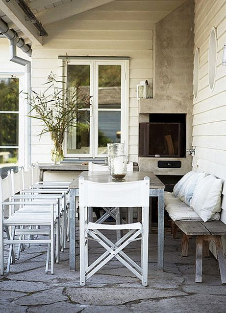 Love the mix of the metal table with the rustic bench and the beautiful outdoor fireplace