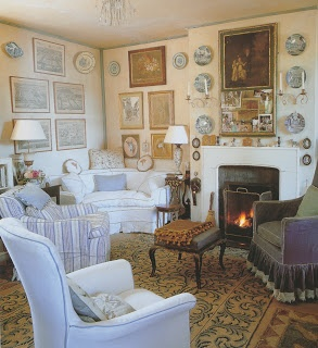Room of the Day: sitting room by Nancy Lancaster: one of my favorite rooms of all time - love the color, arrangement of art and plates, fabrics, inviting charm of the room. 5.10.2013