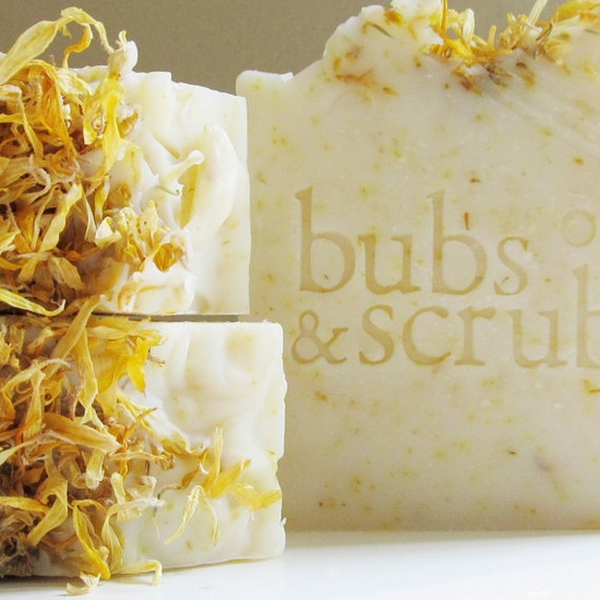Relax Ylang Handmade Soap - A gentle and relaxing blend of ylang ylang and citrus essential oils. Ylang ylang has an exotic scent that is described as sweet, herbal, and floral. We find it extremely calming ; hence the name. Organic calendula petals are mixed in throughout the bar for a super gentle scrub.