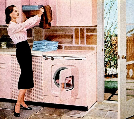 Folding laundry in style, 1957. #vintage #1950s #laundry #pink #appliances #homemaker