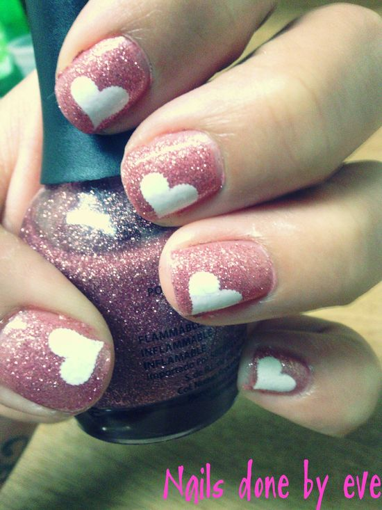 White hearts on glittery pink nails