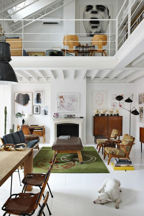 12 Loft Mezzanines: This hip abode in Madrid is home to fashion designer David Delfin and architect-turned-photographer Gorka Postigo. Vintage furnishings and amazing artwork dot the all-white space, which was photographed by Manolo Yllera. The mezzanine level is all open, housing the master bedroom and bathroom.