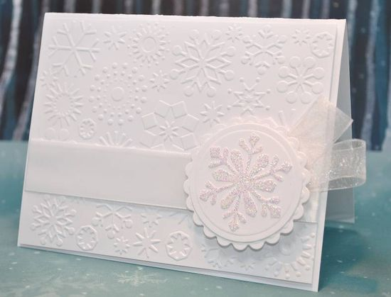 handmade card ... white on white ... snowflake theme .. medallion with stamped and embossed snowflake ,... snowflake embossing folder texture ... organdy ribbon  ... clean, simple, elegant ...