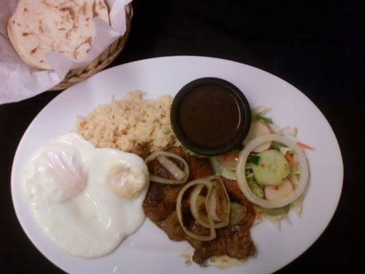 Bistec Y Huevos :Steak and eggs served with rice, beans, sour cream, and handmade tortillas #rice #salad #Food forked.com