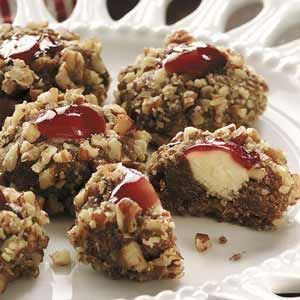 White Chocolate Raspberry Thumbprints: 3/4 cup butter, softened- 1/2 cup packed brown sugar- 2 eggs, separated- 1-1/4 cups all-purpose flour- 1/4 cup baking cocoa- 1-1/4 cup finely chopped walnuts- Filling: 4 oz white baking chocolate, coarsely chopped- 1/4 cup seedless raspberry jam...click to see