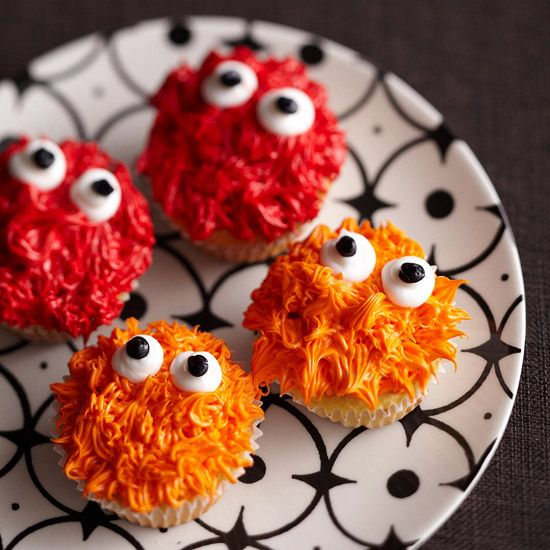 Spiky Monster Cupcakes! So fun! More Halloween-inspired cupake ideas: www.bhg.com/...