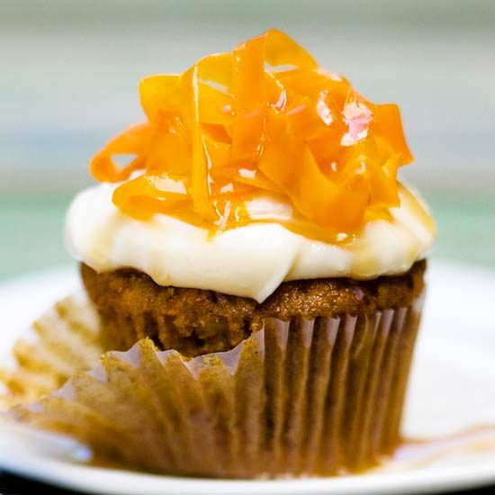 Carrot Cake Cupcakes - These moist cupcakes feature all the luscious goodness of carrot cake with a rich and creamy cheesecake frosting.  More spring time desserts: www.bhg.com/...