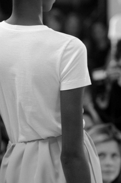 white t-shirt with pleated skirt.