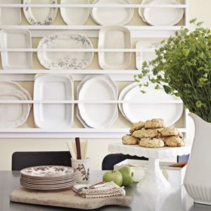 7 ways to organize your antiques and collections. Tip 1: Display items that are hard to store, like these plates proudly displayed on a custom rack in the kitchen.