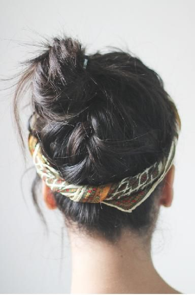 updo-french braided back, with messy twisted bun, and scarf/headband.