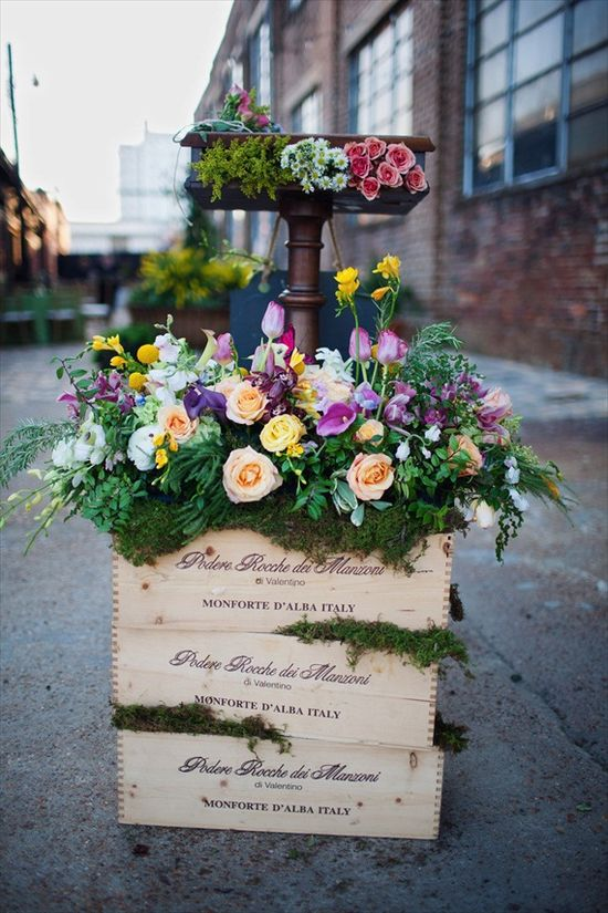 wine boxes filled with flowers - wine themed wedding ideas