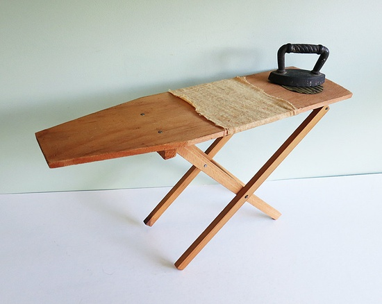 "Vintage Child-Sized Ironing Board with a Toy Cast Iron ""Sad "" Iron."