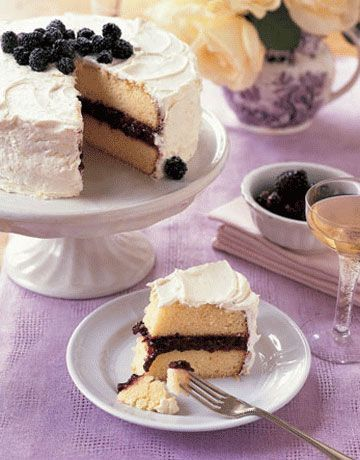 Filled with cassis-spiked blackberry jam and coated with lemon buttercream, our Lemon-Blackberry Cake is a perfect #Easter treat. #recipes