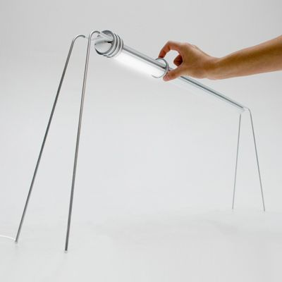 Very well designed lamp by German industrial designer Matthias Pinkert. Called RIMA, this lamp can be dimmed by sliding any of the metal rings along the length of the LEDs. By rotating a secondary ring on the base ring one can adjust the angle, colour and intensity of the light.