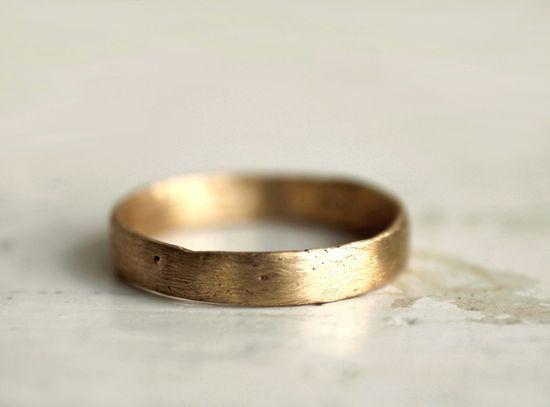 A rustic gold wedding band. $935.00, via Etsy.