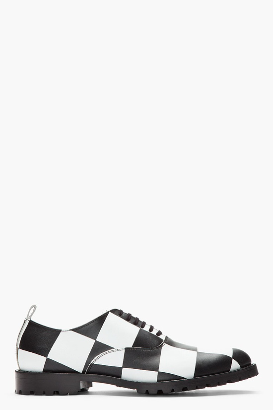 Comme Des Garons Homme Plus Black And White Checkerboard Leather Oxfords -  Comme Des Garons Homme Plus Black And White Checkerboard Leather Oxfords Comme Des Garons Homme Plus Low top leather shoes in black and white checkerboard print. Almond toe. Oxford style lace up closure in black. White leather pull loop at heel collar. Black lug sole. Tone on tone...