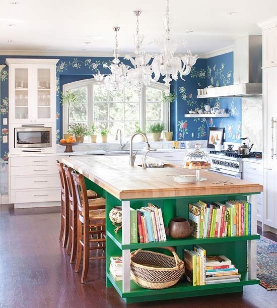 BHG-Viva Jewel Box Kitchen:  Emerald green island with open shelving for cookbooks, butcher-block top.  Floral Wallpaper adds interest to white