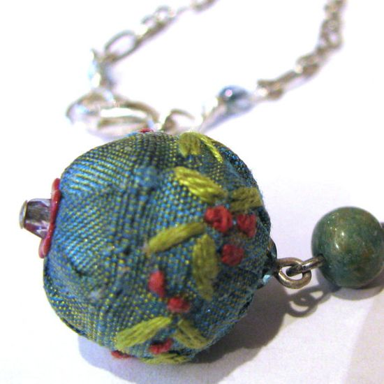 Embroidered fabric over wooden beads