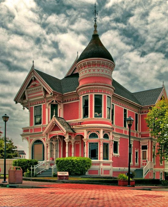 Victorian house with pink walls and a slate blue roof.DG