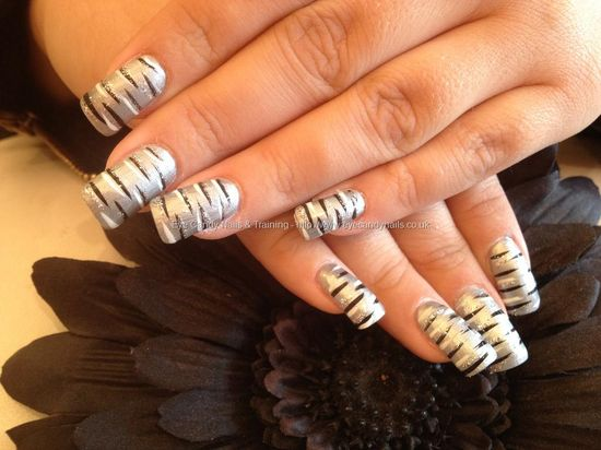Acrylic nails with silver polish and nail art