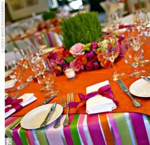 Creative way of using bright colored ribbon on the tablecloth..
