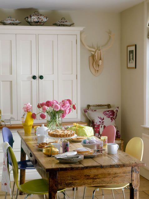 Dining Room Decor Ideas: Rainbow Room    Colorful dining chairs and whimsical decorations lighten up a sturdy farm table and boxy cabinet.