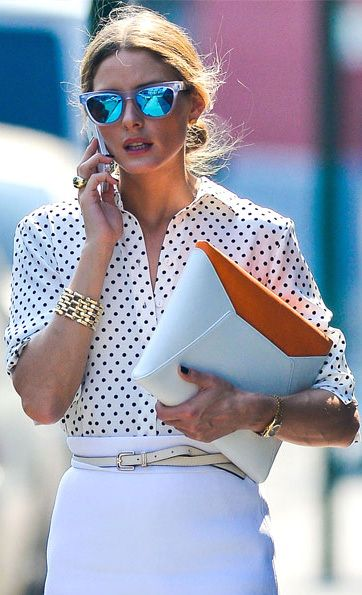 Olivia Palermo donned a Scanlan & Theodore white skirt and Reiss ivory belt, Westward Leaning reflective shades and white-and-orange Smythson 'Cooper' iPad clutch.