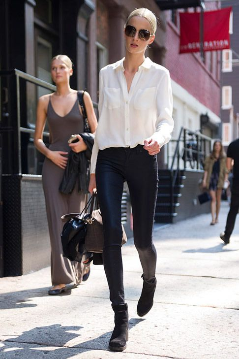 Leather pants and a white blouse.