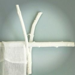 DIY. use twigs & white paint to create curtain rods