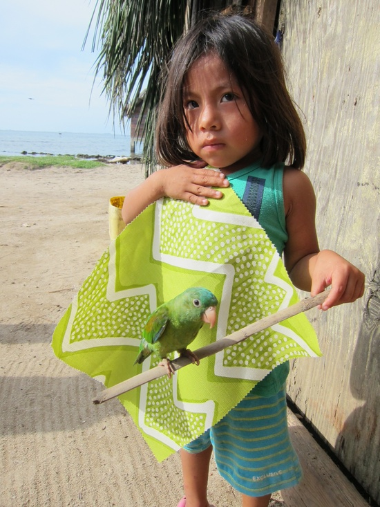 Kuna girl and pet parrot with a remnant of oomph pillow fabric.