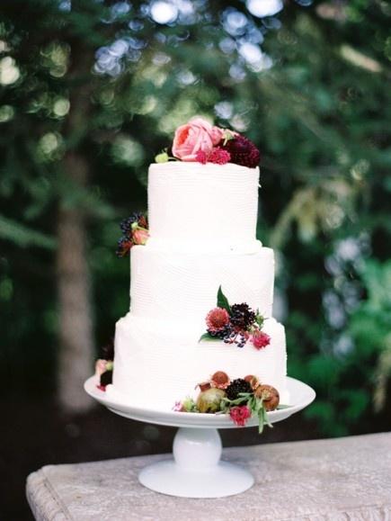 white wedding cake with fruit