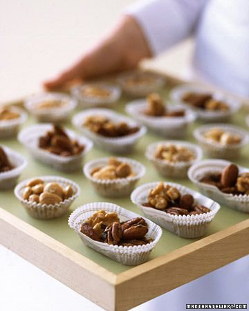 At a cocktail hour, pass candy cups of sweet and savory roasted nuts for a delicious, no-fuss treat. Each paper bowl holds just the right snack-size amount. Our homemade mix is served with store-bought Marcona almonds.