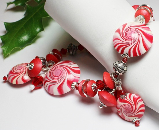 Handmade Jewelry Bracelet Beaded Christmas Holiday Peppermint Red White Polymer Clay Beads Swirl Spiral Crystal...Candy Cane Lane. $48.00, via Etsy.