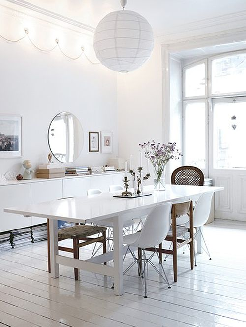 White wooden floors with mismatched dining chairs