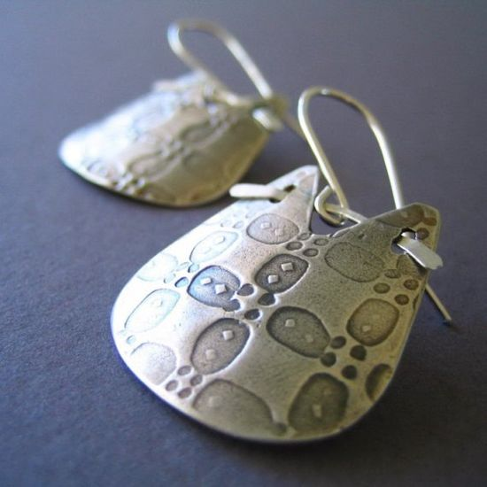 Love the way these earrings hang and connect to the ear wire!